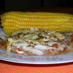 Uunikala tomaatti-sipulipedillä